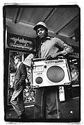 Teenage boy carrying his ghetto blaster, 42nd Street, New York City,USA
