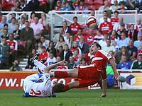 Photo: Andrew Unwin.<br />Middlesbrough v Blackburn Rovers. The Barclays Premiership. 23/09/2006.<br />Middlesbrough's Mark Viduka (R) battles with Blackburn's Andre Ooijer (L).