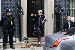 London, UK. 21st November, 2018. Prime Minister Theresa May leaves 10 Downing Street to attend Prime Minister's Questions in the House of Commons on the day on which she is scheduled to travel to Brussels to attend discussions with Jean-Claude Juncker, President of the European Commission, regarding a political declaration to accompany the EU withdrawal agreement.
