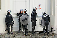 2011 feb 10 Brussels. Belgian Firemen attack government buildings in Brussels against pension reforms. Police takes a coffebreak soaked and dirty of water and powder. credits REPORTERS/SANDERDEWILDE