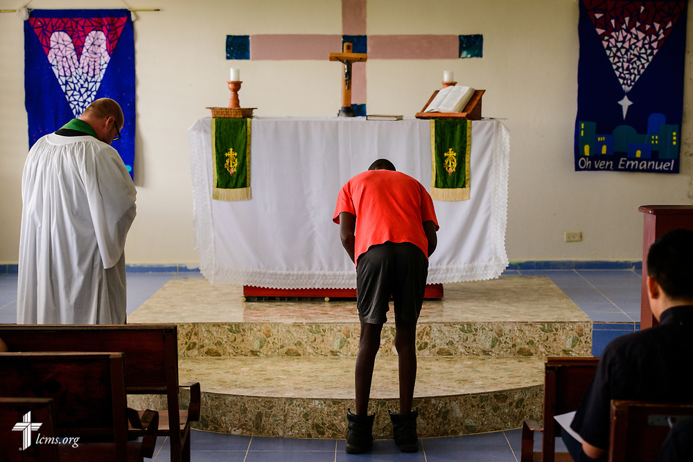 A man who acolytes bows at the altar during chapel at Concordia Reformer Lutheran Seminary and Mercy Center in Palmar Arriba, Dominican Republic, on Wednesday, Oct. 18, 2017. LCMS Communications/Erik M. Lunsford