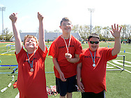 NEWTOWN, PA - APRIL 26:  From left, Ben Averall (3rd place), Luke O'Donnell (1st place) and Anthony Zeglinksi (2nd place) stand on the awards platform after receiving their medals for tennis during a Special Olympics Track and Field Meet at Council Rock North High School April 26, 2014 in Newtown, Pennsylvania. Over 600 athletes competed at the high school. (Photo by William Thomas Cain/Cain Images)