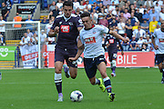 Gary Madine and George Thorne battling for the ball during the Sky Bet Championship match between Bolton Wanderers and Derby County at the Macron Stadium, Bolton, England on 8 August 2015. Photo by Mark Pollitt.