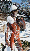 """A figure called """"Red David"""" wearing a hat of snow."""