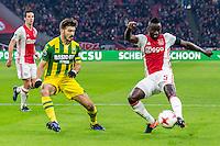AMSTERDAM - Ajax - ADO , Voetbal , Eredivisie , Seizoen 2016/2017 , Amsterdam ArenA , 29-01-2017 ,  eindstand 3-0 , ADO Den Haag speler Edouard Duplan (l) in duel met Ajax speler Davinson Sanchez (r)