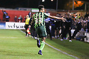 Lyle Taylor forward for AFC Wimbledon (33) scores to make it 2-2 and celebrates by running towards the bench during the Sky Bet League 2 play-off 2nd leg match between Accrington Stanley and AFC Wimbledon at the Fraser Eagle Stadium, Accrington, England on 18 May 2016. Photo by Stuart Butcher.