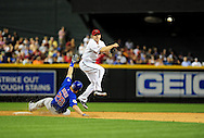 Apr. 29 2011; Phoenix, AZ, USA; Arizona Diamondbacks second basemen Kelly Johnson (2) gets the force out at second base and throws to first to attempt a double play during the eighth inning against the Chicago Cubs at Chase Field. The Cubs defeated the Diamondbacks 4-2.  Mandatory Credit: Jennifer Stewart-US PRESSWIRE....