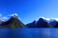 The towering mountain of Mitre Peak towers over Milford Sound on the South Island of New Zealand.