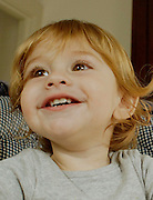 Photos of 18 month old boy with varied expressions.