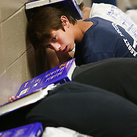 Adam Robison | BUY AT PHOTOS.DJOURNAL.COM<br /> Donovan Caldwell, 13, an eighth grader at Mooreville Middle School, looks down the hall as he holds a textbook over his head during a tornado drill Wednesday morning in Mooreville.