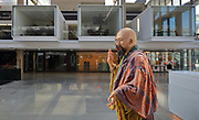 Buddhist holy men at Station F, the world's largest startup business centre, housed in the Halle Freyssinet, a former rail freight depot, in the 13th arrondissement of Paris, France. The space houses 3000 desk spaces for 1000 start up companies and corporate partners, along with an auditorium, games areas, lounges, cafes and restaurants. The building was originally built by Eugene Freyssinet and opened in 1929, but was remodelled by Wilmotte and Associates and reopened in 2017. Picture by Manuel Cohen