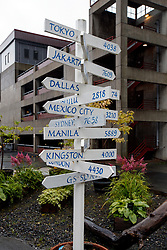 Directional sign showing distance to major cities around the world, Juneau, Alaska, United States of America