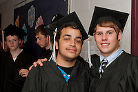 Graduating seniors Brian MacDonald Jr  and Ryan Sargent prepare to enter the auditorium at Prospect Mountain High School for Commencement exercises Friday evening.  (Karen Bobotas/for the Laconia Daily Sun)