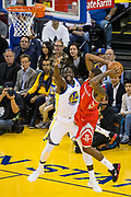 Golden State Warriors forward Draymond Green (23) defends Houston Rockets forward Trevor Ariza (1) at Oracle Arena in Oakland, Calif., on October 17, 2017. (Stan Olszewski/Special to S.F. Examiner)