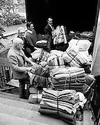 Volunteers from Concern Load blankets and clothing relief for refugees, to be transported via Bombay in India.<br />