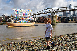 "© Licensed to London News Pictures. 04/09/2019. LONDON, UK. A pupil from Ark Atwood Primary Academy, Westminster takes part in the photocall for the  launch of ""The Ship of Tolerance"" at Tate Modern, Bankside.  The floating installation by Emilia Kabakov (of Russian conceptual artist duo Ilya and Emilia Kabakov) forms part of Totally Thames Festival and will be moored 4 September to 31 October.  The goal of the artwork is to educate and connect the youth of the world through the language of art. (Permission to photograph obtained)   Photo credit: Stephen Chung/LNP"