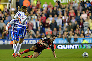 Michael Hector and Yann Kermorgant during the Sky Bet Championship match between Reading and Bournemouth at the Madejski Stadium, Reading, England on 14 April 2015. Photo by Adam Rivers.