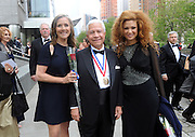 Journalist Meredith Vieira, left, and Grammy Award-winning violinist Miri Ben-Ari, right, pose with Nasser J. Kazeminy, Chairman, National Ethnic Coalition of Organizations (NECO), before the 2015 Ellis Island Medal of Honor awards ceremony, Saturday, May 9, 2015, in New York.  Vieira and Ben-Ari were one of 101 award recipients. NECO's mission is to honor and preserve the diversity of the American people and to foster tolerance, respect and understanding among religious and ethnic groups. (Photo by Diane Bondareff/Invision for NECO/AP Images)