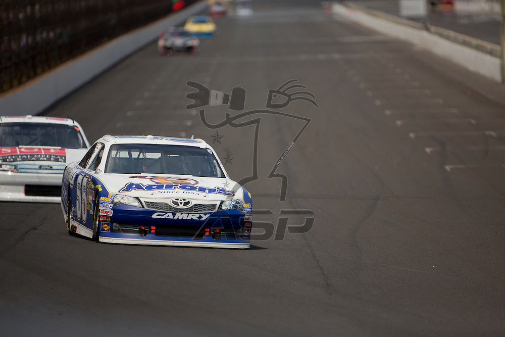 INDIANPOLIS, IN - JUL 29, 2012:  Mark Martin (55) brings his car down the front stretch during the Curtiss Shaver 400 presented by Crown Royal Sprint Cup Series race at the Indianapolis Motor Speedway in Indianapolis, IN.