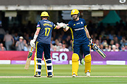 50 - Sam Northeast of Hampshire celebrates scoring a half century and is congraulated by James Fuller of Hampshire during the Royal London 1 Day Cup Final match between Somerset County Cricket Club and Hampshire County Cricket Club at Lord's Cricket Ground, St John's Wood, United Kingdom on 25 May 2019.