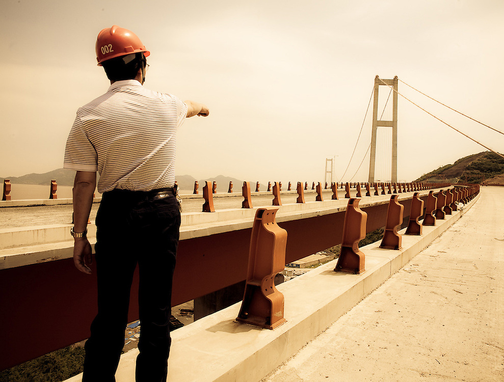 Chinese foreman on new bridge construction,