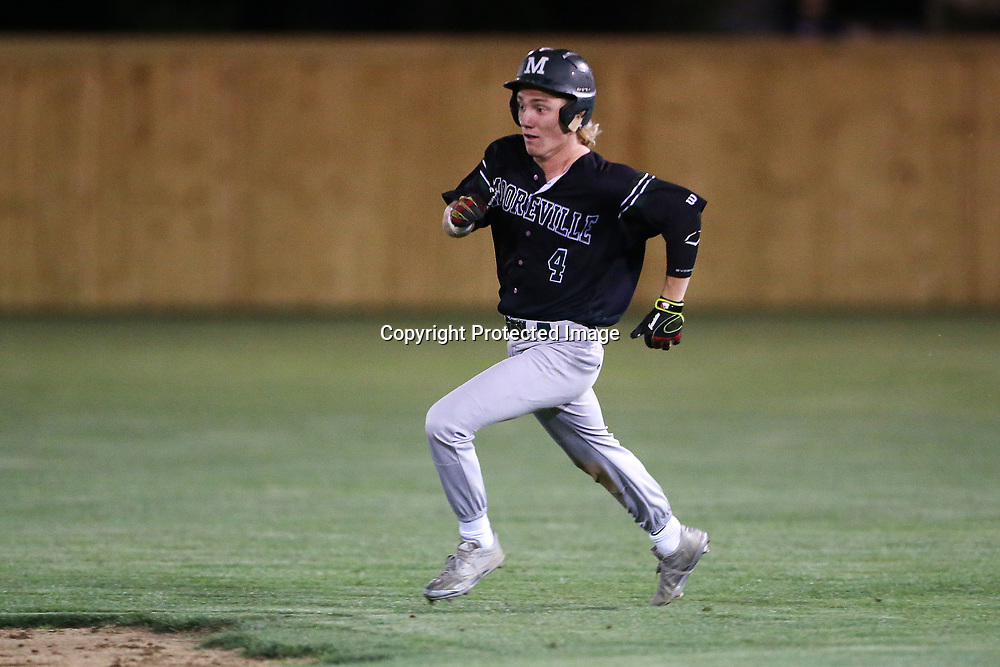 Mooreville's Andrew Peugh runs to second base after hitting a double during Friday night's playoff game at Nettleton.