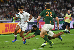 England's Anthony Watson evades the tackle of South Africa's Damian de Allende during the 2019 Rugby World Cup final match at Yokohama Stadium.