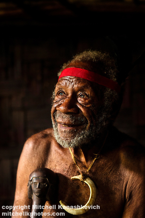 Portrait of a village chief with a pig tusk. In Vanuatu curved pig tasks symbolize chiefly status.