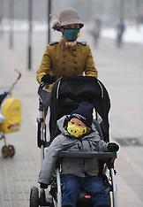 JAN 23 2013 Citizens wearing masks walk in fog in Beijing