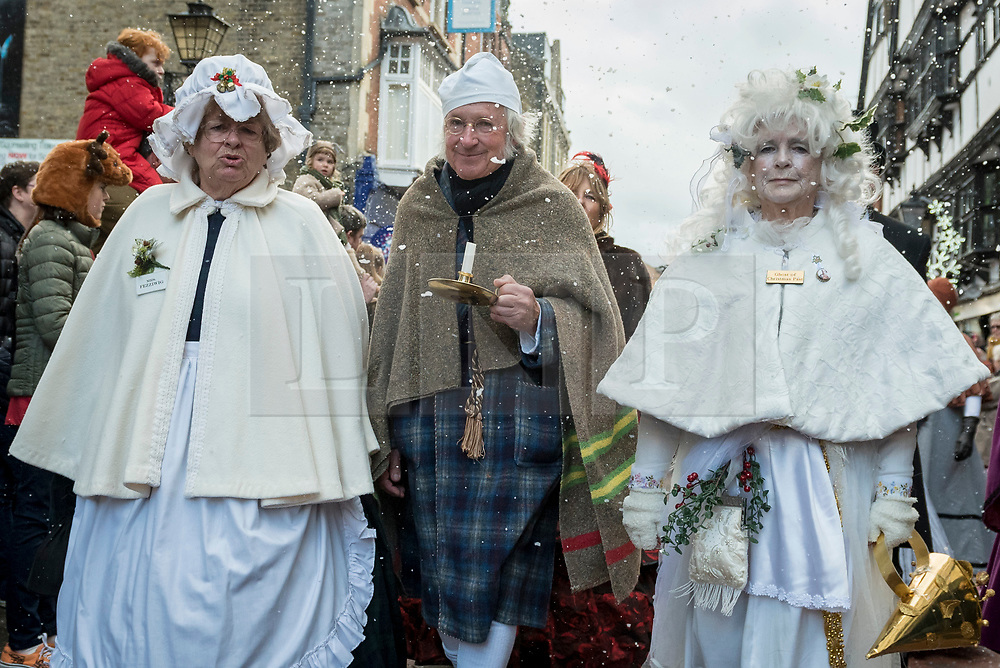 © Licensed to London News Pictures. 02/12/2018. ROCHESTER, UK.  Participants, including Scrooge and The Ghost of Christmas Past, take part in the annual Dickensian Christmas Festival in Rochester.  The Kent town is given a Victorian makeover to celebrate the life of the writer Charles Dickens (who spent much of his life there), with Victorian themed street entertainment, costumed parades and a Christmas market.  Photo credit: Stephen Chung/LNP