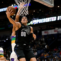 Feb 12, 2019; New Orleans, LA, USA; Orlando Magic forward Aaron Gordon (00) shoots over New Orleans Pelicans center Jahlil Okafor (8) during the first quarter at the Smoothie King Center. Mandatory Credit: Derick E. Hingle-USA TODAY Sports