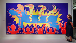 """© Licensed to London News Pictures. 25/06/2019. LONDON, UK. A staff member views """"Untitled"""", 10 June 1984, by Keith Haring from Opera Gallery at a preview of Masterpiece London 2019, the world's leading cross-collecting art fair held in the grounds of the Royal Hospital Chelsea.  The fair brings together 157 international exhibitors presenting works from antiquity to the present day and runs 27 June to 3 July 2019.  Photo credit: Stephen Chung/LNP"""