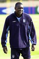 Photo. Glyn Thomas<br />England Training-prior to England v Croatia international friendly.<br />Five Lakes. 19/08/2003.<br />Emil Heskey is in relaxed mood as England prepare for tomorrow's friendly match.