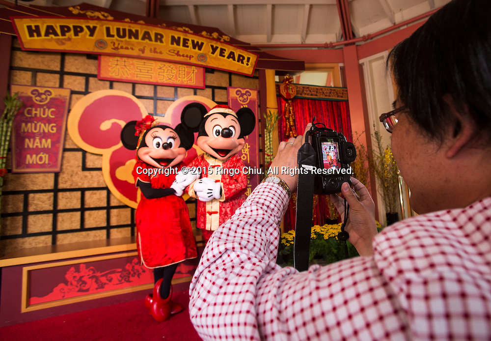 Mickey Mouse and Minnie Mouse pose for guests at the Paradise Garden in Disney California Adventure Park during the Happy Lunar New Year Celebration on Saturday February 21, 2015 in Anaheim, California. (Photo by Ringo Chiu/PHOTOFORMULA.com)