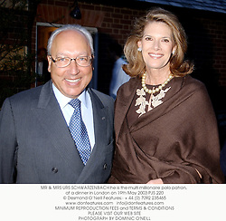 MR & MRS URS SCHWARZENBACH he is the multi millionaire polo patron, at a dinner in London on 19th May 2003.PJS 220
