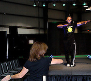 Peggy Mary of Union (left) follows Zumba instructor Doug Jones of The Studio Fitness during the Dayton Women's Fair at the Airport Expo Center in Vandalia., Saturday, September 17, 2011.