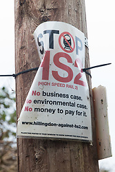 Harefield, UK. 14 January, 2020. A Stop HS2 poster close to a protection camp from which Stop HS2 activists are being evicted by enforcement agents. Part of the nearby Colne Valley protection camp was evicted by bailiffs last week. 108 ancient woodlands are set to be destroyed by the high-speed rail link and further destruction of trees for HS2 in the Harvil Road area is believed to be imminent.