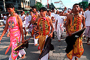 THAILAND, PHUKET ISLAND Chinese Vegetarian Festival,  believer considered spirit mediums in a trance, do body piercing