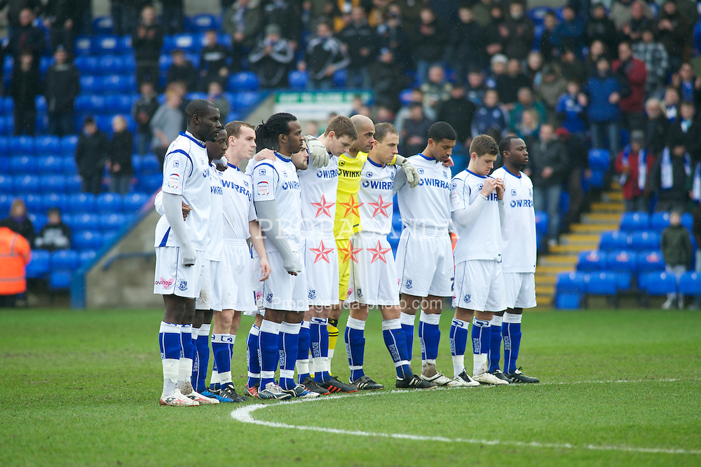 PETERBOROUGH, ENGLAND - Saturday, February 19, 2011: Tranmere Rovers' players respect a minutes silence against Peterborough United during the Football League One match at London Road. (Photo by Gareth Davies/Propaganda)