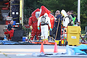 "Members of the Springfield Missouri Hazardous Materials (HAZMAT) team are decontaminated after they entered a home where a suspicious white powder was found in an envelope in a Southwest Missouri woman's mail on May 22, 2012 in Springfield, Missouri. After four hours, the team declared ""all clear"" for the area and determined there was no threat to the public. (David Welker / TurfImages.com).."