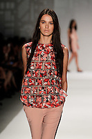 A model walks the runway wearing Vivienne Tam Spring 2014 during Mercedes-Benz Fashion Week in New York on September 8, 2013