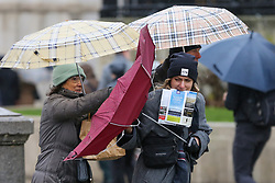 © Licensed to London News Pictures. 15/12/2018. London, UK. A woman struggles with an umbrella during a wet, cold, blustery day in London. Photo credit: Dinendra Haria/LNP