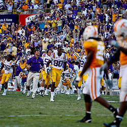 Oct 2, 2010; Baton Rouge, LA, USA; LSU Tigers players celebrates following a victory over the Tennessee Volunteers at Tiger Stadium. LSU defeated Tennessee 16-14.  Mandatory Credit: Derick E. Hingle