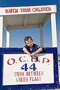 Portrait of a boy on a lifeguard stand at the beach, Ocean City, New Jersey, USA
