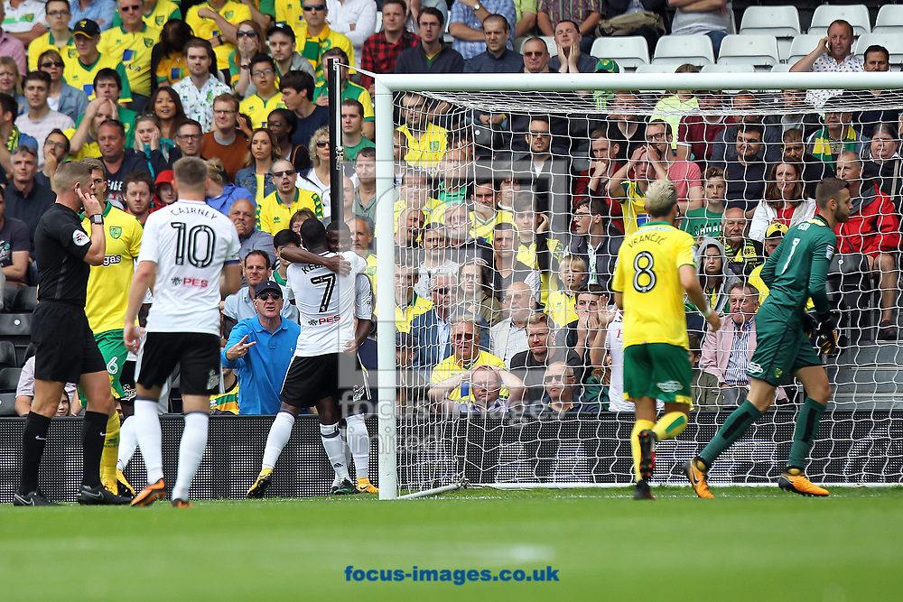 The Norwich players look dejected as the Fulham players celebrate their side&rsquo;s 1st goal which was credited as an own goal by Russell Martin of Norwich during the Sky Bet Championship match at Craven Cottage, London<br /> Picture by Paul Chesterton/Focus Images Ltd +44 7904 640267<br /> 05/08/2017