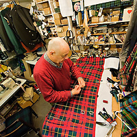 LONDON, ENGLAND - JANUARY 23:  A kiltmaker in London put the final touches  to a kilt ready to be collected for Burns night on Monday on January 23, 2010 in London, England. Scots across the world annually celebrate on January 25th the life of Robert Burns, the country's most famous bard, with recitations of his poetry, the eating of haggis and imbibing of whisky.  (Photo by Marco Secchi/Getty Images)