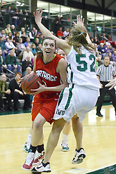 29 January 2011: Dani Ripkey lowers her shoulder against Stacey Arlis and draws an offensive penalty during an NCAA Womens basketball game between the Carthage Reds and the Illinois Wesleyan Titans at Shirk Center in Bloomington Illinois.