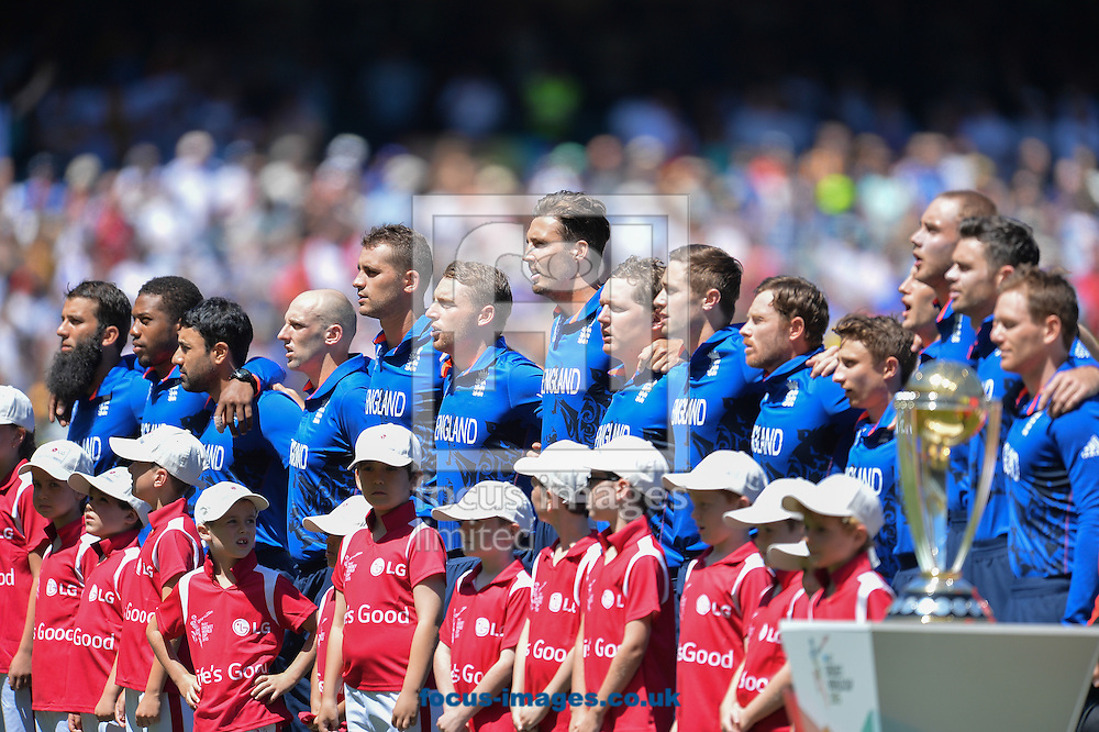 The players of England stand for the national anthem during the 2015 ICC Cricket World Cup match at Melbourne Cricket Ground, Melbourne<br /> Picture by Frank Khamees/Focus Images Ltd +61 431 119 134<br /> 14/02/2015