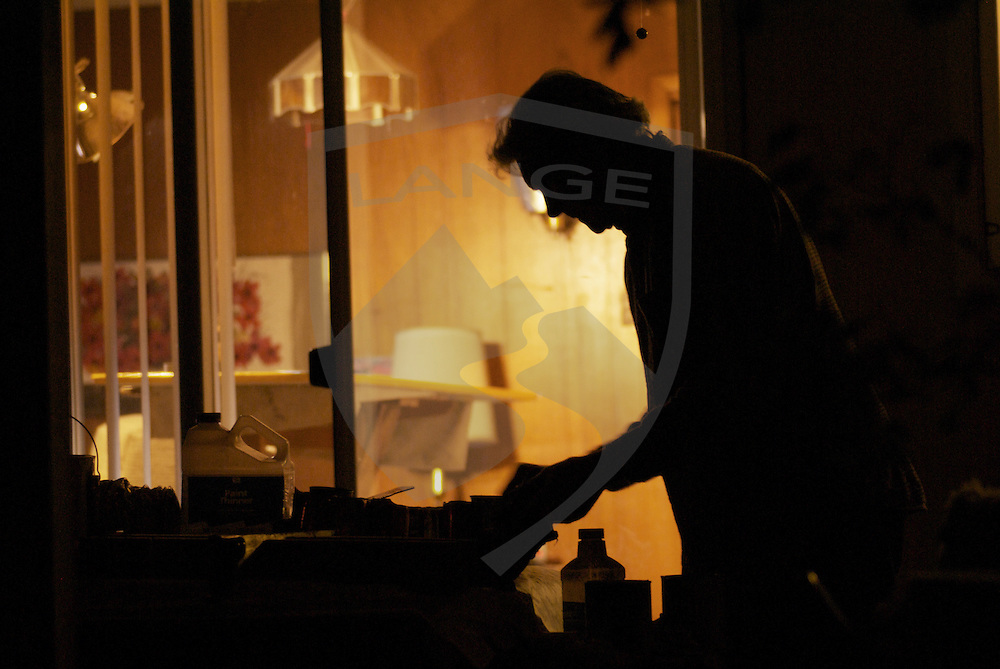 senior man silhouette working with interior of his home behind him, albuquerque, new mexico