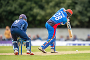 Rahmat Shah (#08) plays a shot to bring up his century during the One Day International match between Scotland and Afghanistan at The Grange Cricket Club, Edinburgh, Scotland on 10 May 2019.
